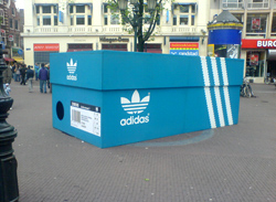 dc298fc57f9 Adidas recently placed an oversized shoebox in the middle of Leidseplein  (Leidse Square) in central Amsterdam, to promote its newly opened concept  store; ...